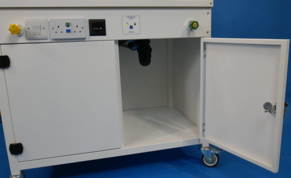 A Durapipe Vulcathene anti siphon bottle trap beneath the benching of the fume cupboard. Vulcathene is the market leading labratory drainage product range.